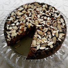 Jagermeister Christmas Cake:  1kg mixed fruit, 200g unsalted butter, 1 cup water, 395g condensed milk, 1 tbs white vinegar, 3 tbs Jagermeister, 2 cups flour, 1 tsp baking soda, 1 tsp baking powder, 2 tsp cinnamon, ½ tsp ginger, 1 tsp nutmeg, ½ tsp ground cloves. Soak fruit in water overnight.  Put fruit, butter and water into a pan and heat. Let it cool down then add everything else. Cook at 150C for 2 hours. Cover with jam glaze then sliced almonds.