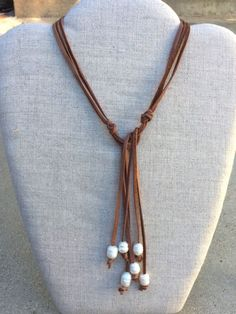 Brown Suede wraparound necklace with Freshwater pearls. Simply wrap it around your neck and tie it the length you prefer.