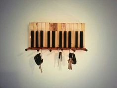 Key holder. Took apart a decrepit piano and salvaged the parts. Upcycle!