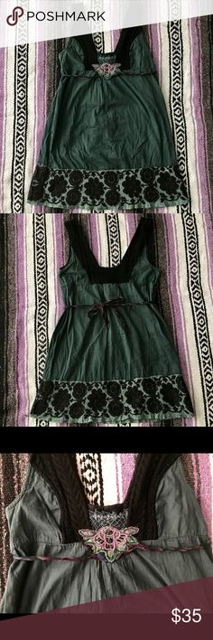 Free People dark grey and black design dress Dark grey with black design tank top dress, black flower on bottom, black braided design on both straps, pretty pink flower in the middle of the chest, colorful braided tie strap, one side that is supposed to be connected to the flower is disconnected a bit but does not affect the wear of the dress or use of the tie strap, super cute and unique, love this dress. Free People Dresses