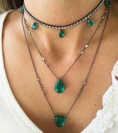 Layered emerald and diamond necklaces
