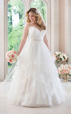 This A-line wedding dress from Stella York features Royal organza and a fitted…