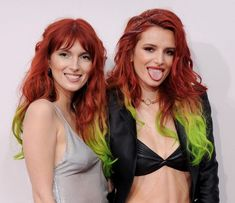 Actress Bella Thorne, right, and sister Dani Thorne rocked the same red and green ombre hair. (Photo: Getty Images)