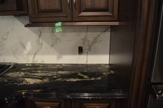 Granite countertop & Dekton backsplash