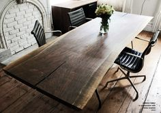 \\ wood slab table & black channel tufted eames task chairs