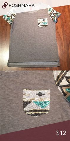 Aztec sequin pocket tee Only worn once, excellent condition, made by Fashionomics and bought from a local boutique. Cloth is like a sweatshirt material on the outside and terry cloth on the inside Tops