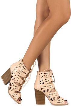 """Chic and sophisticated, the Bare Necessity sandal from Qupid is a perfect accessory! This trendy caged sandal is ideal for the fashionista in you!  Faux leather upper Back zipper closure Ghillie lace-up Cutout details Round peep toe 3½"""" stacked block heel Synthetic sole Imported"""