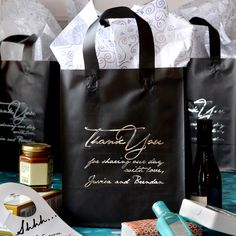 Black poly frosted gift bags printed with Thank You message and bride and groom's name in Metallic Silver imprint color