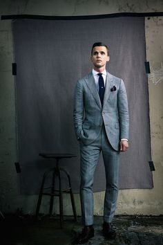 Pairing a grey plaid blazer with grey tartan dress pants will create a powerful and confident silhouette. Black leather double monks will add a new dimension to an otherwise classic look.  Shop this look for $204:  http://lookastic.com/men/looks/pocket-square-double-monks-dress-shirt-tie-dress-pants-blazer/4172  — Navy Pocket Square  — Black Leather Double Monks  — White Dress Shirt  — Navy Tie  — Grey Plaid Dress Pants  — Grey Plaid Blazer