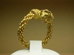 Anello pompeiano teste di leone oro 18Kt .