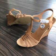 Brand New Nine West Tan Wedges Brand-new, never worn. Super comfortable. Perfect for spring and summer. Dress up or down, jeans or a cute dress. I do not trade. I accept reasonable offers. These are perfect casual wedges. Not too high with their wedge height being approximately 4 inches. Shoes Wedges