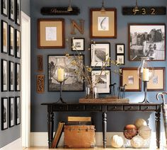 Collection of photos and letters arranged on large wall space. Great for dining room area.