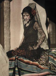 Autochrome: Clifton R. Adams. A young  woman poses in a black mantilla costume. El Paso, Texas, USA. 1920s.