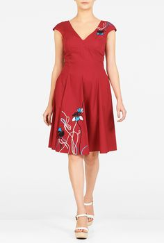 Vibrant embroidery patterns our seamed empire waist dress with a paneled skirt that cinches in at the waist and flares out to a full silhouette.