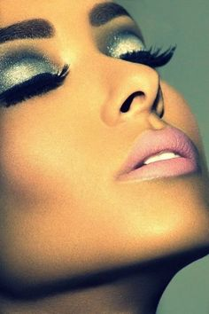 Glamorous makeup - bronze skin, pink lips, long eyelashes, and glitter eye shadow