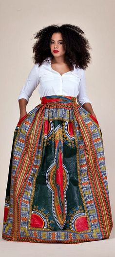 """Green Dashiki Skirt. Relaxed yet sophisticated and, best of all, universally flattering – just look how it nips in the waist – a full, high waisted skirt is an instant game-changer with two side pockets and approximately 2"""" waist band.     Ankara 