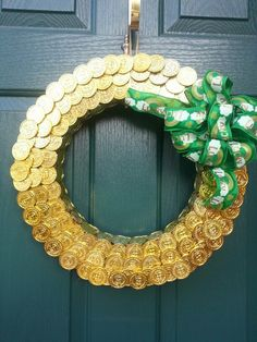 St. Patrick's Day Wreath:  - styrofoam wreath form - plastic gold coins - hot glue - bow attached with floral pins