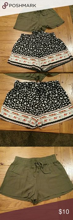 Super cute cloth shorts! Each only worn one time! Selling both for $10. Army green ones are XS & have longer pockets in front & the black are S, have no pockets, & have ribbon attached to make a bow. Shorts