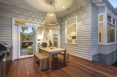 Rear deck / Alfresco Contemporary Weatherboard Home on a sloping block.
