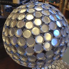 Silver bottle cap light globe. very much DIY could make for cute decor..