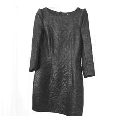 H&M Black 3/4 Sleeve Dress (8) - Gaga-like Get a dose of Gaga style with this fun LBD from H&M. 100% polyester, 100% polyester lining (slight tear in lining at seam. Faux leather detail on shoulder.  Size 8, but runs small. Would fit a 6 or 4. Zipper and button closure in back. H&M Dresses Mini