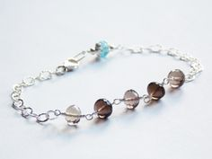 "Treasured Bracelet!  -Smoky Quartz gemstones in varying shades and a Blue Topaz gemstone for a pop of colour... or a bride's ""something blue""!  All components are sterling silver!"
