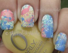 I used OPI Alpine Snow as a base. The splatter is with Orly Lemonade, Orly Cotton Candy, Orly Gumdrop, Orly Snowcone.