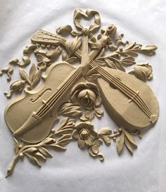 "For music lovers, our Louis XVI composition carving #11720 — 11"" x 11""."