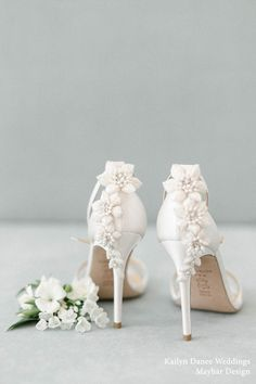 bridal shoes Its all about the back! Full blooms embellished with teardrop pearls and ivory beads create a garden-like illusion for Gardenia. Tiny vines trickling down to the heel adds a perfect touch to this statement heel. Shop for Gardenia today! Wedding Shoes Heels, Bride Shoes, Bridal Heels, Wedding Shoes Bride, Designer Wedding Shoes, Bridal Shoes Ivory, Unique Wedding Shoes, Ivory Shoes, White Wedding Shoes
