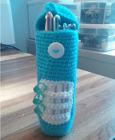 "Standing pencil case or hook case measures about 6½"" tall and 1¾"" in diameter. Pattern includes optional space to store tapestry needles and stitch markers if using for a hook case."