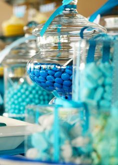 Candy Table Decor idea for sweet 16 party Cake pops, other candies, cow tales, marshamallow sticks and chocolate and marshmallows and graham crackers. All in mason jars with ribbon/tissue paper