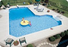 This looks like our pool! Idea...brick edging the concrete.