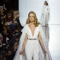 Lebanese designer Zuhair Murad has quickly established himself as a main attraction on the Haute Couture Week scene in Paris. This season, the rippling embroidery, pleating in waves around the waist, Watteau backs mimicking waterfalls, whirlpools of tulle at the shoulders, plunging necklines, a swimsuit bodice with a crystal-encrusted mermaid overlay, were an evocation of water.  https://www.flickr.com/photos/senatusnet/16419146232/ Crystals took the place of beads of condensation on ...