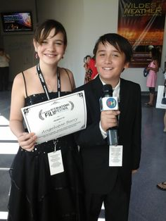 Kidzhubber Connor Mullen interviewing me with my certificate in hand.