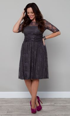 Plus size lace dress that is sure to make you want to do twirls and curtsies! The Plus Size Luna Lace Dress by Kiyonna is available in a beautiful Twilight Grey color for Fall.  Pair it with silver stripy sandals for a monochromatic look or opt for a pop of color with magenta or cobalt blue pumps.  #plussize #kiyonna