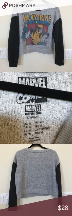 Wolverine marvel comics off shoulder sweatshirt m Comic-Con fans with wolverine in mind - my son loved when I showed up to pick him up from school in this . It's a bit big on me - it has baseball style dark color blocked sleeves and can fall slightly off shoulder and is cropped right at the waist. Great condition - no holes stains or tears Marvel Tops Sweatshirts & Hoodies