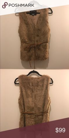 FAUX fur vest, caramel brown, size S FAUX (not real) fur vest, two hook closure in front plus leather waist tie belt (completely detachable), no pockets, really cute with jeans/boots for winter.  No size tag but it is a small and could fit size 2, 4, 6.  Hand wash, hang dry.  Never worn so has not been washed, NWOT. Jackets & Coats Vests