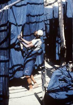 3x1: Lengths of indigo-dyed cotton hanging in Zabid, Yemen...