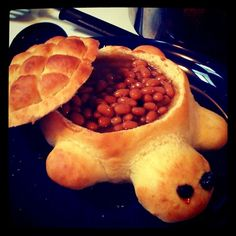 Baked beans served in a turtle bread bowl! Used this recipe but made two mini turtles per batch. Almost too cute to eat! Food with a face :) http://www.tablespoon.com/recipes/turtle-bread-recipe/1/