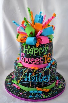 """This cake was fun to make! I had such a blast splattering the cake with royal icing """"paint""""!"""