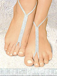 Foot Jewelry. If you're having an outside wedding how cute is this? Goes with the whole feel.   Alternative to shoes, Ms. WildChildBareFoot Denvir? -P.