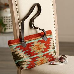 Handmade by artisans in the village of Teotitlan del Valle, the woven pattern on this bag features a Zapotec butterfly, an agave bloom, and a flash of lightning. Zapotec Butterfly and Blossom Purse | National Geographic Store