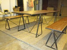 Urban Rustic Dining table with 2 benches. Stained ply and iron bases.    http://HillcrestDecor.com