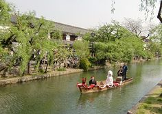 Dream boat A bride and groom sail through a canal during their wedding procession. Kurashiki Okayama JP