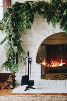 Asymmetrical garland: an unexpected take on traditional Holiday fireplace mantel decor. Hear my thought process and how to create the look at your house. Christmas Holidays, Christmas Decorations, Diy Christmas Mantel Garland, Merry Christmas, Christmas Greenery, Cottage Christmas, Woodland Christmas, Christmas Colors, Holiday Decorating