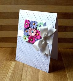 Pretty flower card. Love the way the punched flowers have been layered into a square then trimmed at edges