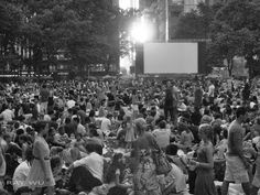 Outdoor movie crowd at Bryant Park in the Summer by Ray Wu.