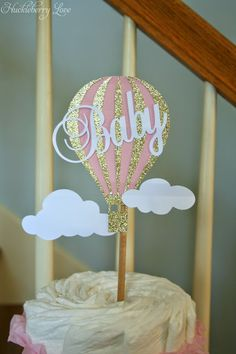Cute pink and gold hot air balloon topper for a diaper cake.