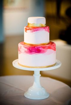 Brides.com: . Inspired by the couple's modern art-gallery setting (the Pennsylvania Academy of the Fine Arts), Zoë Lukas of Whipped Bakeshop created this three-tiered confection featuring vanilla-buttermilk cake and passion-fruit meringue buttercream and decorated with bright pink and gold brushstroke accents.   $8.75 per slice, Whipped Bakeshop