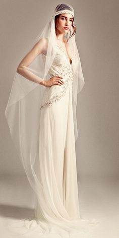 TEMPERLEY BRIDAL FALL 2014: Fluid silk chiffon and soft tulle dress with deep v neckline and embellished bodice. Folded organza flower and crystal embe...